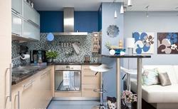 Kuchnia połączona z salonem. Wykończyć jak kuchnię czy jak salon?